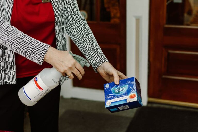 Sanitizing groceries at retirement home