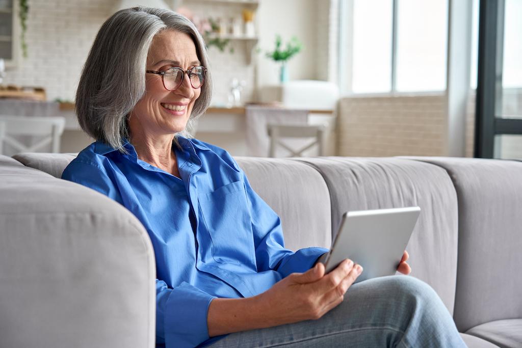 Senior happy older woman at home at viideo